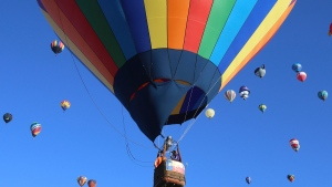 FILE - In this Oct. 6, 2019, file photo, hot air balloons fly over Albuquerque, N.M., during the Albuquerque International Balloon Fiesta. The balloon festival is returning after a pandemic hiatus with plans to launch about 540 hot-air balloons in a stunning visual spectacle. The nine-day event starts Saturday, Oct. 2, 2021. (Jerry Larson/Waco Tribune-Herald via AP, File)