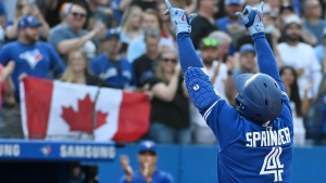 Toronto Blue Jays' George Springer (4) celebrates after a solo home run in the second inning of an American League baseball game against the Baltimore Orioles in Toronto on Saturday, Oct. 2, 2021. THE CANADIAN PRESS/Jon Blacker