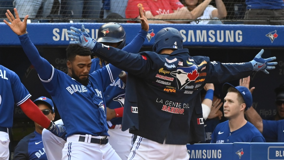 Toronto Blue Jays' George Springer, right, celebrates with Teoscar Hernandez, left, after a solo home run in the second inning of an American League baseball game against the Baltimore Orioles in Toronto on Saturday, Oct. 2, 2021. THE CANADIAN PRESS/Jon Blacker