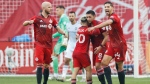 Toronto FC midfielder Marco Delgado (8) celebrates his goal with teammates Yeferson Soteldo (30), Michael Bradley (4) and Omar Gonzalez (44) during first half MLS soccer action against the Chicago Fire, in Toronto, Sunday, Oct. 3, 2021. (Cole Burston/The Canadian Press via AP)