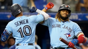 Toronto Blue Jays second baseman Marcus Semien (10) celebrates his solo home run with teammate Vladimir Guerrero Jr. (27) during fifth inning MLB baseball action against the Baltimore Orioles, in Toronto, Sunday, Oct. 3, 2021. THE CANADIAN PRESS/Frank Gunn