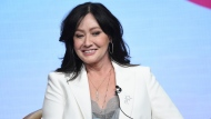 """Shannen Doherty participates in Fox's """"BH90210"""" panel at the Television Critics Association Summer Press Tour on Aug. 7, 2019, in Beverly Hills, Calif. (Photo by Chris Pizzello/Invision/AP, File)"""