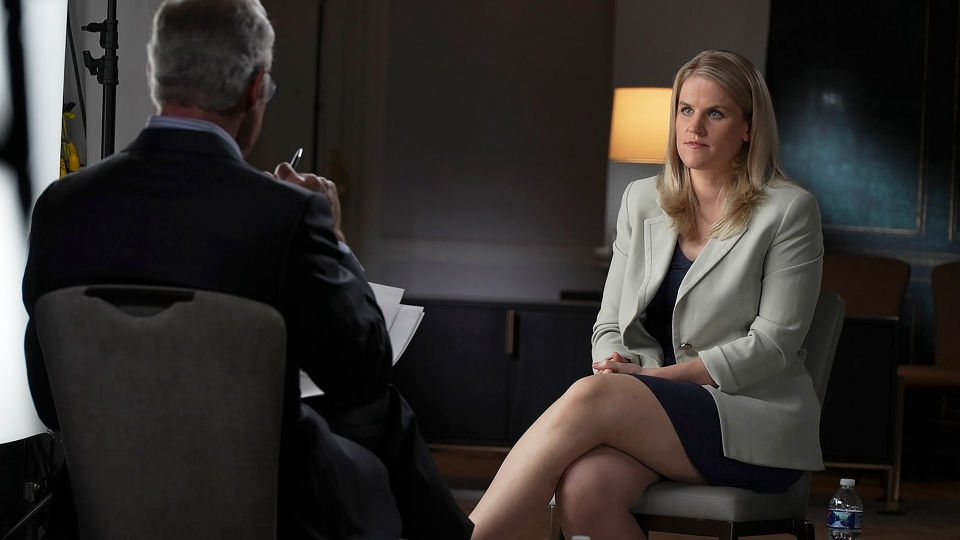 """In this photo provided by CBS, Facebook whistleblower Frances Haugen talks with CBS' Scott Pelley on """"60 Minutes,"""" in an episode that aired Sunday, Oct. 3, 2021. (Robert Fortunato/CBS News/60 Minutes via AP)"""