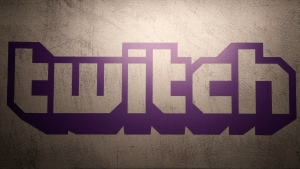 This Saturday, Nov. 4, 2017, file photo shows the logo of live streaming video platform Twitch at the Paris games week in Paris. (AP Photo/Christophe Ena, File)