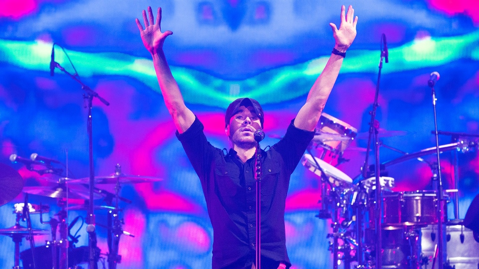 Singer Enrique Iglesias performs live in front of fans during a concert in Toronto on Thursday, October 7, 2021. THE CANADIAN PRESS/Nathan Denette