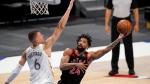 Dallas Mavericks center Kristaps Porzingis (6) defends against a shot by Toronto Raptors center Khem Birch (24) in the second half of an NBA basketball game in Dallas, Friday, May 14, 2021. (AP Photo/Tony Gutierrez)