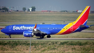 A Southwest Airlines jetliner taxis down a runway for take off from Denver International Airport Friday, July 2, 2021, in Denver. Southwest Airlines canceled hundreds more flights Monday, Oct. 11, 2021 following a weekend of major service disruptions. By midmorning Monday, Southwest had canceled about 360 flights and more than 600 others were delayed. (AP Photo/David Zalubowski, file)