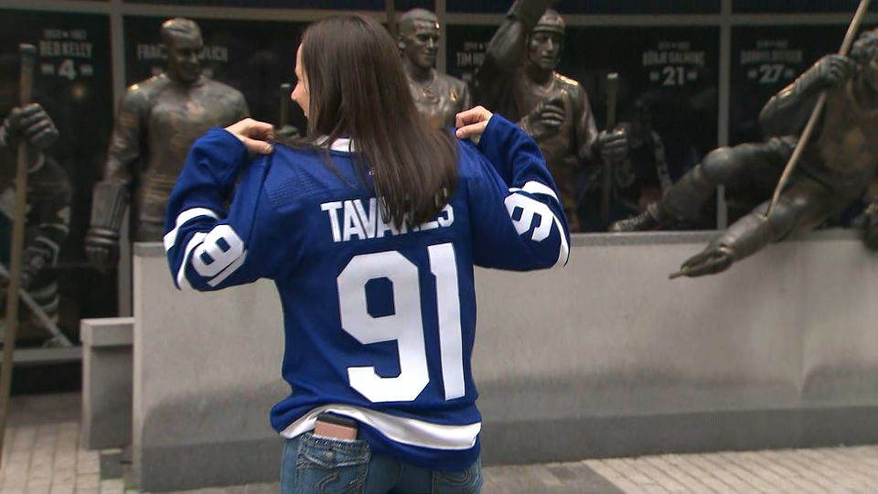 A Toronto Maple Leafs fan shows off her jersey outside of Scotiabank Arena ahead of the Maple Leafs' home opener Wednesday, October 13, 2021.