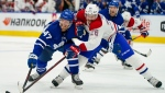 Toronto Maple Leafs forward Pierre Engvall (47) battles for a loose puck against Montreal Canadiens defenceman Jeff Petry (26) during second period NHL action in Toronto on Wednesday, October 13, 2021. THE CANADIAN PRESS/Evan Buhler