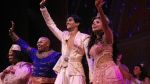 """This image released by Disney Theatrical Productions shows, from second left, Michael James Scott as Genie, Michael Maliakel as Aladdin, and Shoba Narayan as Jasmine after a performance of the Broadway musical """"Aladdin"""" in New York on Sept. 28, 2021. (Curtis Brown/Disney Theatrical Productions via AP)"""