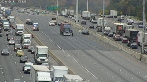 Police respond to the eastbound express lanes of Highway 401 just east of Yonge Street after a pedestrian was struck on the highway Thursday October 14, 2021.