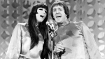"""FILE - In this Jan. 21, 1966 file photo, Sonny, right, and Cher sing during a taping of """"The Danny Thomas Special"""" in Los Angeles. Cher has sued the widow of her former musical partner and ex-husband Sonny Bono over royalties for Sonny and Cher songs including """"I Got You Babe"""" and """"The Beat Goes On."""" In a federal lawsuit filed Wednesday, Oct. 13, 2021, Cher alleges that former Rep. Mary Bono and other defendants have attempted to terminate provisions of business agreements Cher and Sonny Bono reached when they divorced in 1975 that entitled each to 50% of songwriting and recording royalties. (AP Photo/File)"""