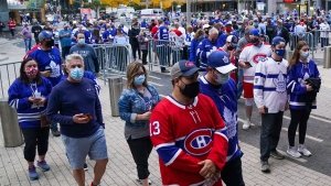 Fans eagerly wait outside the Scotiabank Arena before the start of the Toronto Maple Leafs first game of the season against the Montreal Canadiens in Toronto on Wednesday, October 13, 2021. THE CANADIAN PRESS/Evan Buhler