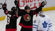 Ottawa Senators right wing Tyler Ennis, centre, celebrates his goal with Drake Batherson as Toronto Maple Leafs goaltender Petr Mrazek looks on during first period NHL action, Thursday, October 14, 2021 in Ottawa. THE CANADIAN PRESS/Adrian Wyld