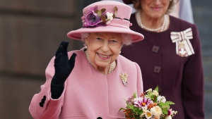 Britain's Queen Elizabeth II leaves after the opening ceremony of the sixth session of the Senedd in Cardiff, Wales, Thursday Oct. 14, 2021. (Jacob King/PA via AP)