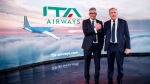 Fabio Lazzerini, left, CEO of new national carrier ITA, poses with President Alfredo Altavilla during the presentation in Rome, Friday, Oct. 15, 2021. Italy's new national carrier ITA made its inaugural flight Friday and unveiled its new name and logo, recycling the red-white-and-green brand of its Alitalia origins but trying to chart a new future. ITA, or Italy Air Transport, officially launched Friday after the bankrupt Alitalia made its last flights Thursday night, ending a 74-year business history. (Roberto Monaldo/LaPresse via AP)