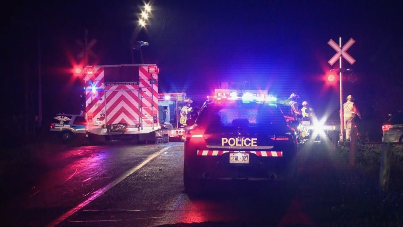 Police respond to a fatal collision involving a passenger vehicle and a train in New Tecumseth, Ont. Thursday, October 14, 2021.