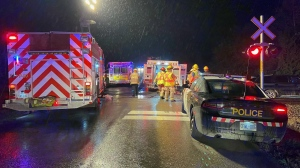 Police respond to a fatal collision involving a passenger vehicle and a train in New Tecumseth, Ont. Thursday, October 14, 2021. (Tristan Phillips /CP24)
