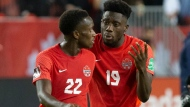 Canada's Alphonso Davies (right) speaks with teammate Richie Laryea after the final whistle following their 4-1 win over Panama in World Cup Qualifying action in Toronto, on Wednesday, October 13, 2021.THE CANADIAN PRESS/Chris Young