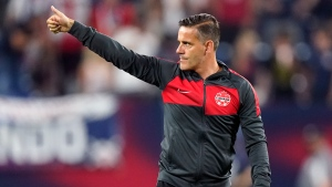 FILE - Canada head coach John Herdman salutes the crowd as he leaves the pitch following a 1-1 draw against the United States in a World Cup soccer qualifier Sunday, Sept. 5, 2021, in Nashville, Tenn. (AP Photo/Mark Humphrey)