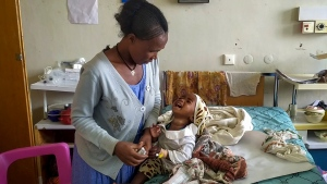 In this image made from video provided anonymously, an unidentified mother and child are seen in the malnutrition ward at the Ayder Referral Hospital in Mekele, in the Tigray region of northern Ethiopia, Tuesday, Sept. 28, 2021. In the regional capital Mekele, a year of war and months of government-enforced deprivation have left the city of a half-million people with a rapidly shrinking stock of food, fuel, medicine and cash. (AP Photo)
