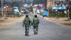 Indian paramilitary soldiers patrols on a road leading towards the site of a gunfight in Pampore, south of Srinagar, Indian controlled Kashmir, Saturday, Oct. 16, 2021. Indian government forces killed five rebels in last 24-hours in disputed Kashmir on Saturday, officials said, as violence increased in recent weeks.(AP Photo/Dar Yasin)