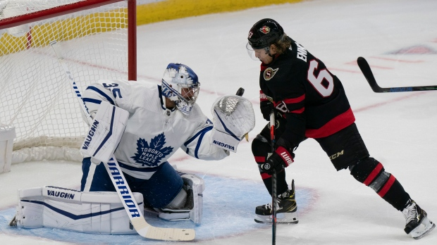 Ottawa Senators right wing Tyler Ennis deflects a shot past Toronto Maple Leafs goaltender Petr Mrazek for a goal during first period NHL action, Thursday, October 14, 2021 in Ottawa. THE CANADIAN PRESS/Adrian Wyld