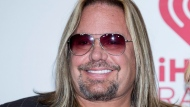 FILE - In this Sept. 19, 2014, file photo, Vince Neil of Motley Crue, arrives at the iHeart Radio Music Festival in Las Vegas. (Photo by Andrew Estey/Invision/AP, File)
