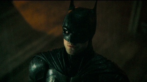 """This image released by Warner Bros. Pictures shows Robert Pattinson in """"The Batman."""" Warner Bros. released the first trailer for """"The Batman,"""" which is Pattinson's first film as the Dark Knight. It will be released March 4, 2022. (Warner Bros. Pictures via AP)"""