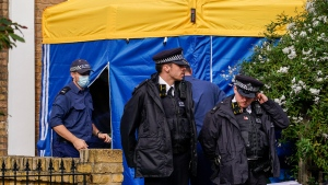 Police officers stand outside a house in north London, thought to be in relation to the death of Conservative MP Sir David Amess, Sunday, Oct. 17, 2021. Leaders from across Britain's political spectrum have come together to pay tribute to a long-serving British lawmaker who was stabbed to death in what police have described as a terrorist attack. (AP Photo/Alberto Pezzali)