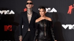 Travis Barker, left, and Kourtney Kardashian arrive at the MTV Video Music Awards at Barclays Center on Sunday, Sept. 12, 2021, in New York. (Photo by Evan Agostini/Invision/AP)