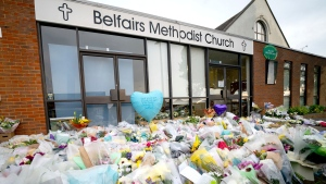 Flowers and tributes at the scene outside Belfairs Methodist Church where Conservative MP David Amess died after he was stabbed several times at a constituency surgery on Friday, in Leigh-on-Sea, Essex, England, Monday, Oct. 18, 2021. British Prime Minister Boris Johnson will lead tributes in the House of Commons to David Amess, a Conservative lawmaker stabbed to death as he met constituents in a church hall. The death of Amess has shocked British politicians. It came five years after Labour Party lawmaker Jo Cox was murdered by a far-right extremist. (Aaron Chown/PA via AP)