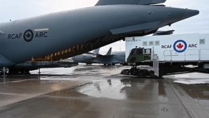 An RCAF medical isolation unit is loaded into the back of a cargo plane in an image from April 2021. (RCAF/DND)