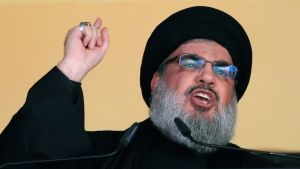 In this Oct. 24, 2015 file photo, Hezbollah leader Sheik Hassan Nasrallah addresses a crowd during the holy day of Ashoura, in a southern suburb of Beirut, Lebanon. On Monday, Oct. 18, 2021, Nasrallah revealed that his militant group has 100,000 trained fighters. (AP Photo/Hassan Ammar, File)