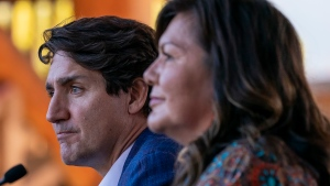 Prime Minister Justin Trudeau pauses for a moment as he listens to Chief Rosanne Casimir as she speaks at the Tk'emlups te Secwepemc in Kamloops, B.C. Monday, Oct. 18, 2021. THE CANADIAN PRESS/Jonathan Hayward