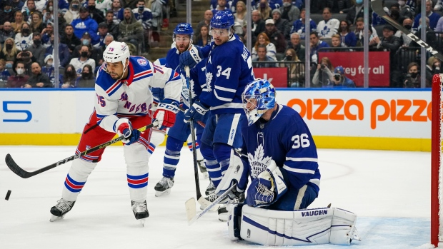 New York Rangers forward Ryan Reaves (75) tries to tip the puck against Toronto Maple Leafs goaltender Jack Campbell (36) during third period NHL action in Toronto, Monday, Oct. 18, 2021. THE CANADIAN PRESS/Evan Buhler
