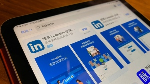 The internet App Store page showing the Chinese LinkedIn app is displayed on a device in Beijing, China, Friday, Oct. 15, 2021. Microsoft is shutting down its main LinkedIn service in China later this year as Beijing tightens its internet rules. (AP Photo/Ng Han Guan)