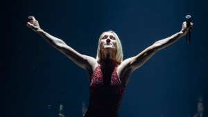 FILE - Singer Celine Dion performs during her first World Tour called Courage in Quebec City, Montreal, Canada on Sept. 18, 2019. A medical issue has forced Dion to delay the opening of a new Las Vegas show. A statement from the singer said she's been having severe and persistent muscle spasms that have kept her from performing. (Jacques Boissinot/The Canadian Press via AP)