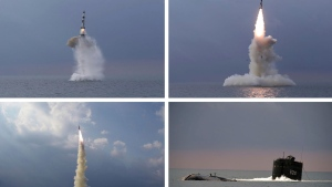 """This combination of four photos provided by the North Korean government shows a ballistic missile launched from a submarine Tuesday, Oct. 19, 2021, in North Korea. North Korea announced Wednesday, Oct. 20, 2021 that it had tested a newly developed missile designed to be launched from a submarine, the first such weapons test in two years and one it says will bolster its military's underwater operational capability. Independent journalists were not given access to cover the event depicted in this image distributed by the North Korean government. The content of this image is as provided and cannot be independently verified. Korean language watermark on image as provided by source reads: """"KCNA"""" which is the abbreviation for Korean Central News Agency. (Korean Central News Agency/Korea News Service via AP)"""