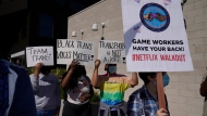 People protest outside the Netflix building in the Hollywood section of Los Angeles, Wednesday, Oct. 20, 2021. Critics and supporters of Dave Chappelle's Netflix special and its anti-transgender comments gathered outside the company's offices Wednesday. (AP Photo/Damian Dovarganes)