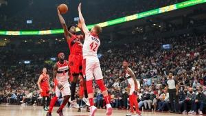 Toronto Raptors forward OG Anunoby (3) shoots over Washington Wizards forward Davis Bertans (42) during first half NBA action in Toronto Wednesday, October 20, 2021. THE CANADIAN PRESS/Evan Buhler