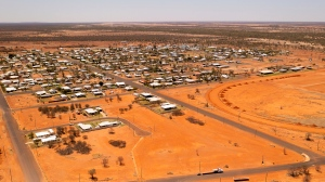 The Australian Outback town of Quilpie is photographed from the air, on Oct. 2, 2021. Quilpie had hoped its offer of a free residential block of land to anyone who would make it their home might attract five new families to the remote community of 800. But authorities have been overwhelmed by more than 250 enquires in less than two weeks from around Australia and internationally. (Leon O'Neil via AP)