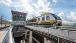 An UP Express train makes its way across an elevated guideway at Pearson Airport. (Metrolinx)