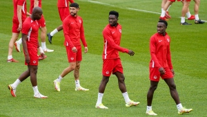 Kamal Miller, left to right, Jonathan Osorio, Alphonso Davies and Richie Laryea of the Canada men's national soccer team train in Toronto on Tuesday, October 12, 2021. THE CANADIAN PRESS/Evan Buhler