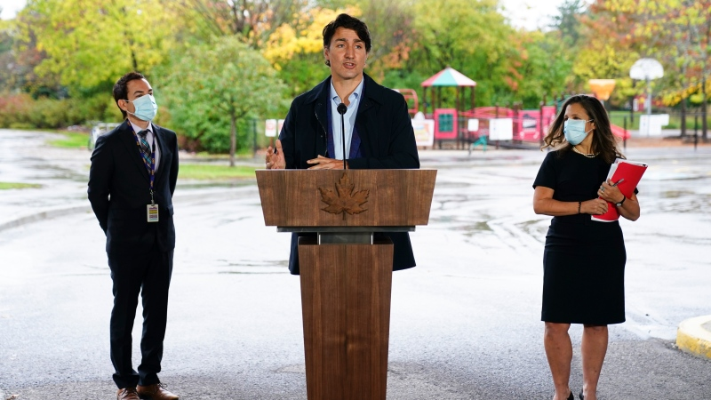 Prime Minister Justin Trudeau speaks during a press conference as he visits the Children's Hospital of Eastern (CHEO) Ontario in Ottawa on Thursday, Oct. 21, 2021. He's joined by Alex Munter, President and Chief Executive Officer of the CHEO, and Minister of Finance and Deputy Prime Minister Chrystia Freeland. THE CANADIAN PRESS/Sean Kilpatrick