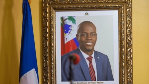 A picture of the late Haitian President Jovenel Moise hangs on the wall of his former home, before a news conference by interim Prime Minister Claude Joseph in Port-au-Prince, Tuesday, July 13, 2021. Moise was assassinated in his home on July 7. (AP Photo/Joseph Odelyn)