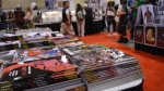 Stacks of comic books and graphic novels are displayed by an exhibitor at Fan Expo Canada in downtown Toronto Saturday September 2, 2017. (Joshua Freeman /CP24)