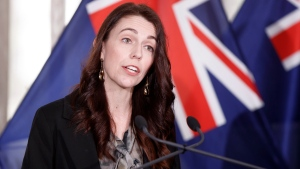 New Zealand Prime Minister Jacinda Ardern announces in Wellington, Friday, Oct. 22, 2021, an ambitious target of fully vaccinating 90% of eligible people to end coronavirus lockdowns. Ardern has been under pressure to provide a pathway to freedom for people living in Auckland, the largest city, who have been in lockdown for more than two months. (Robert Kitchin/Pool Photo via AP)