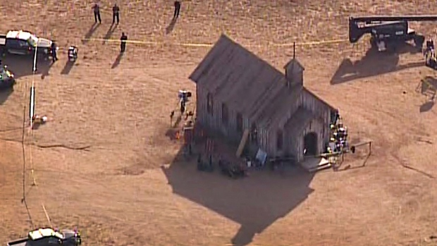 This aerial video image provided by KOAT 7 News, shows Santa Fe County Sheriff's Officers responding to the scene of a fatal accidental shooting at a Bonanza Creek, Ranch movie set near Santa Fe, N.M. Thursday, Oct. 21, 2021. Authorities say a woman has been killed and a man injured Thursday after they were shot by a prop firearm at a movie set outside Santa Fe. The Santa Fe County Sheriff's Office says a 42-year-old woman was airlifted to a hospital, where she died, while a 42-year-old man was getting emergency care at another hospital. (KOAT 7 News via AP)