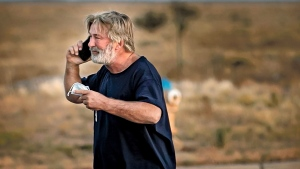 """Alec Baldwin speaks on the phone in the parking lot outside the Santa Fe County Sheriff's Office in Santa Fe, N.M., after he was questioned about a shooting on the set of the film """"Rust"""" on the outskirts of Santa Fe, Thursday, Oct. 21, 2021. Baldwin fired a prop gun on the set, killing cinematographer Halyna Hutchins and wounding director Joel Souza, officials said. (Jim Weber/Santa Fe New Mexican via AP)"""